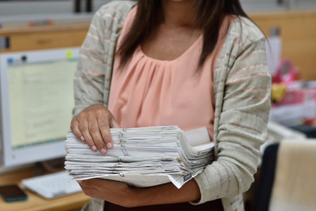 handling: Female employees are handling the file.
