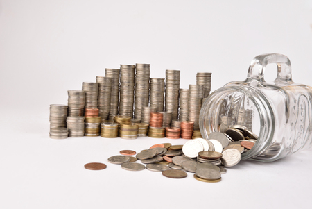 future earnings: stack of coins on isolated background,The concept saving Stock Photo