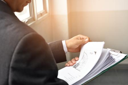 analyzed: businessman Data were analyzed business documents. Stock Photo
