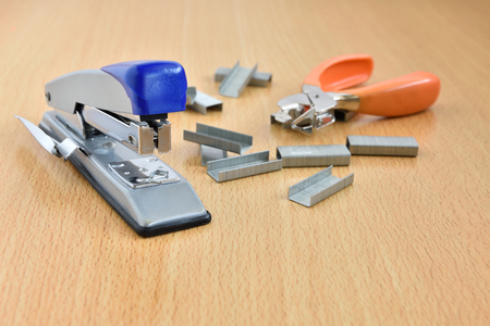 stapled: Staples on wood desk use for work documents files. Stock Photo