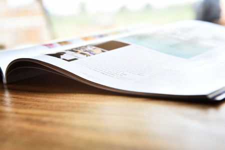 magazine open pace on wood table Stock Photo