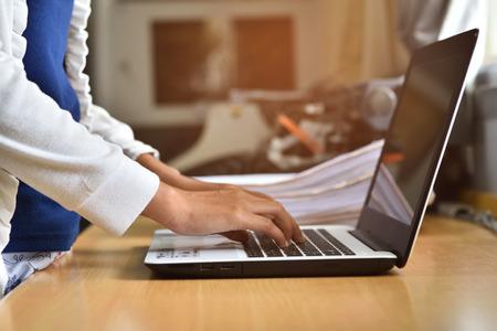 Employ key data into a laptop.
