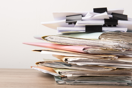 Pile of Financial documents Black clips on wood desk stack up,back isolated background Stock fotó