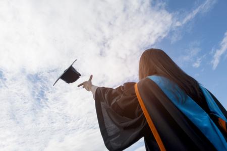 Graduates of the University,Of graduates holding hats handed to the sky. Stock Photo