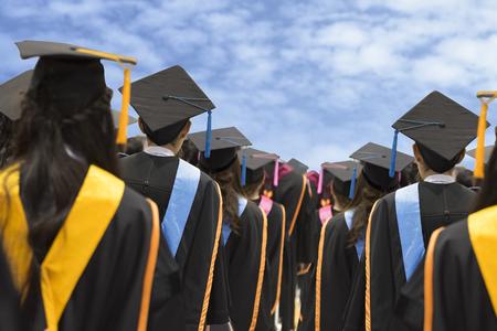 Graduates in university degree graduation,The background image is blue sky. Stock Photo