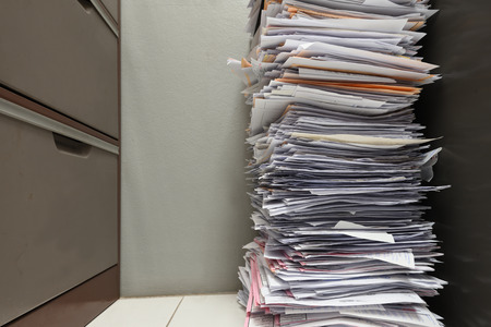Stack of paper documents in the office