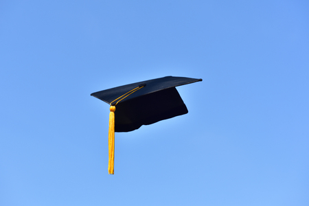Black hat of the graduates floating in the sky. 写真素材 - 93652370