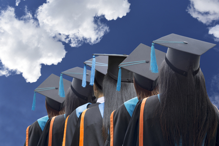 Congratulated the graduates in University background is blue sky,Concept education congratulation