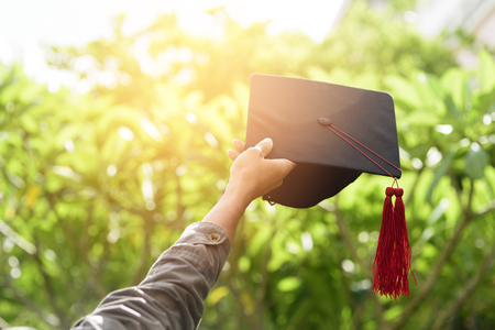 Graduates put out a black hat to express their joy. Stock Photo