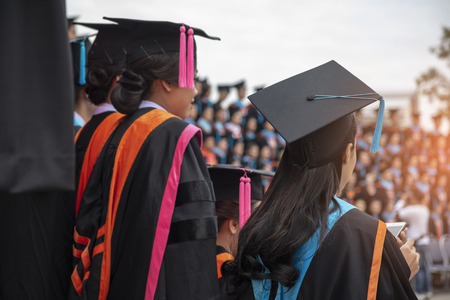 Back of graduation with black blue tail cap at ceremony in graduation in the University.