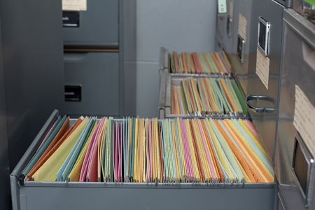 Important documents arranged in a file placed in a filing cabinet.
