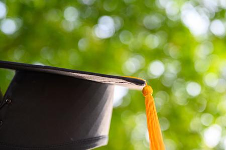 Close-up photos of black graduates hats