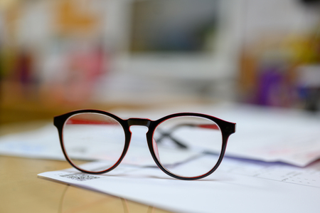 Staff eye glasses placed on the office desk