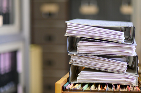 Stacked black documents at the office Imagens