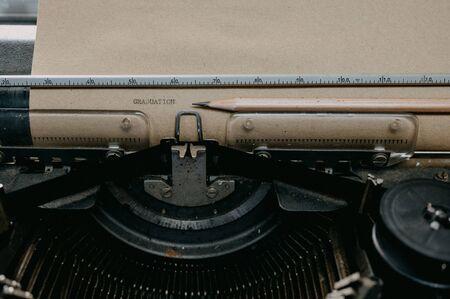 Old black typewriter Type Graduation