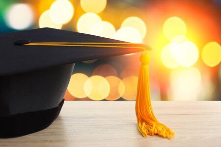 Black hat of university graduates with bokeh Blurred background