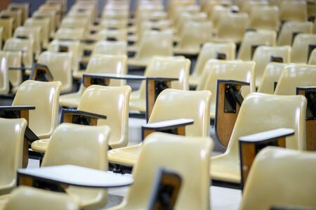 The university classroom is empty. There are no students in the classroom.