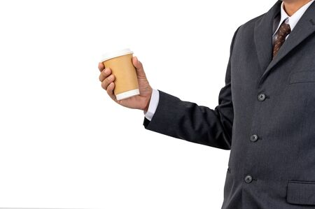 A businessman holding a coffee cup with disposable paper on isolated background and clipping path Standard-Bild