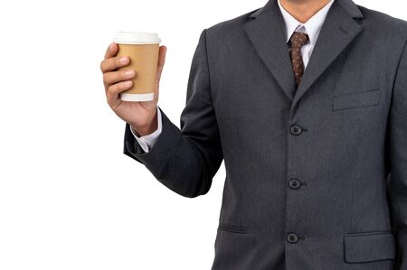 A businessman holding a coffee cup with disposable paper on isolated background and clipping path Stock Photo