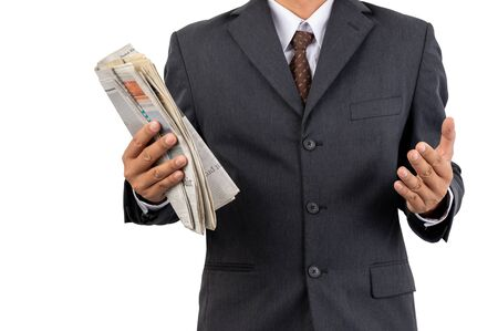 A businessman holding a newspaper on isolated background and clipping path Stock Photo