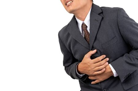 Businessmen grasp the chest with pain on isolated background and clipping path
