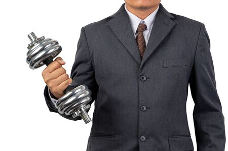 Businessman holding dumbbells on isolated background and clipping path