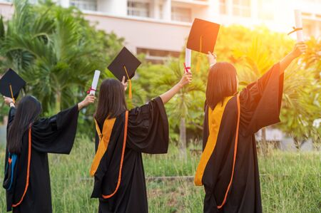 Asian graduates, university graduates, stand with black hats in front
