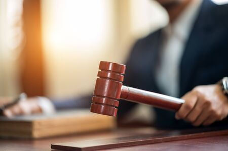 Judge held Wooden Hammer for Adjudge Judicial of Lawyer In the courtroom Stock Photo
