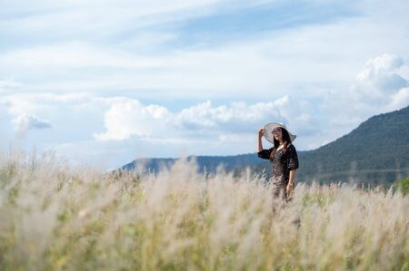 Female tourists walking and resting on mountain meadows Archivio Fotografico