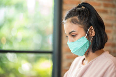 close up Portrait face woman wearing surgical mask for prevent dust and infection virus. 版權商用圖片