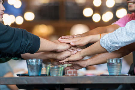 teamwork meeting group of friends join hand together concept
