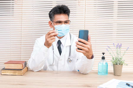 Portrait male doctor wearing a mask with isolated background