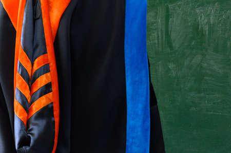 PhD graduate in black graduatio gown University degree