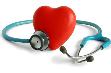 Heart and a stethoscope isolated in white background Stock Photo