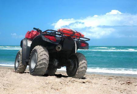 An all-terrain vehicle by the beach photo
