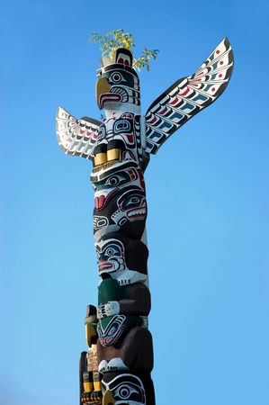 A painted totem pole of the North American Indians in Vancouver, BC