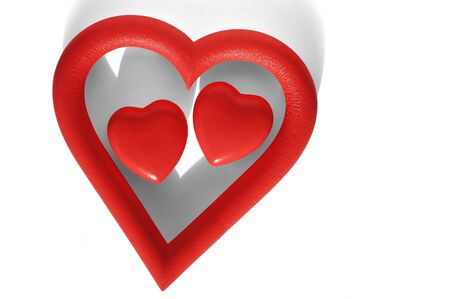 yearning: Two Valentine hearts within a heart-shaped frame in white background.