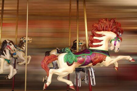 Horse rides at a merry-go-round with background movement