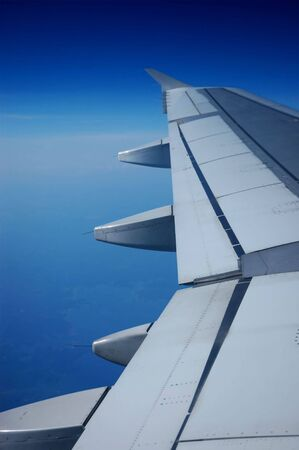 An airplane's wing in flight Stock Photo
