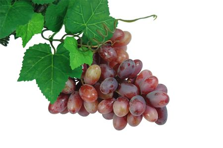 sauternes: A bunch of grapes with leaves Stock Photo