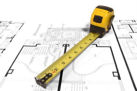 A measuring tape over a construction drawing of a house (design and drawings by the submitter)