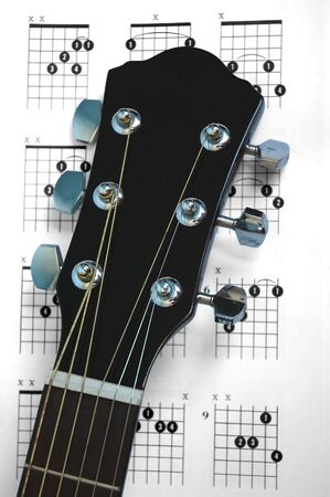 An acoustic guitar over chords chart
