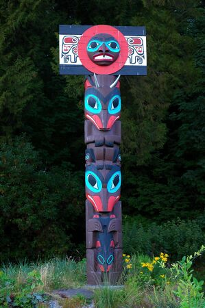 A painted totem pole of the North American Indians in Vancouver, B.C.