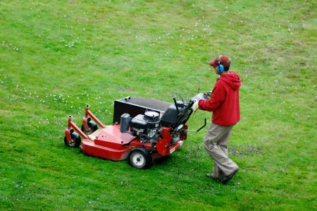 mowing lawn: A man mowing the lawn Stock Photo