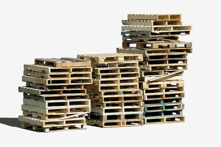 on the skids: Piles of wooden pallets Stock Photo