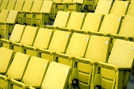 Rows of yellow seats Stock Photo