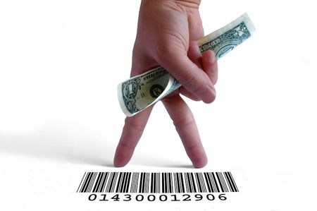 Hand holding a dollar bill on a barcode Stock Photo