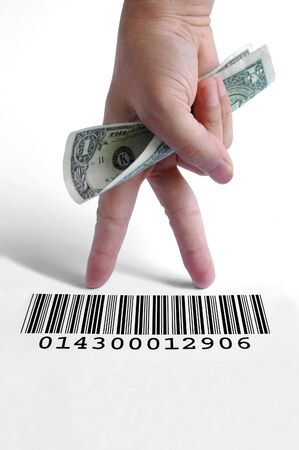 Hand holding a dollar bill on a barcode Stock Photo - 3171916