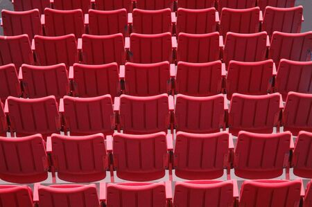 Rows of red seats photo