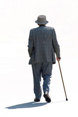 man in shadow: Strolling senior